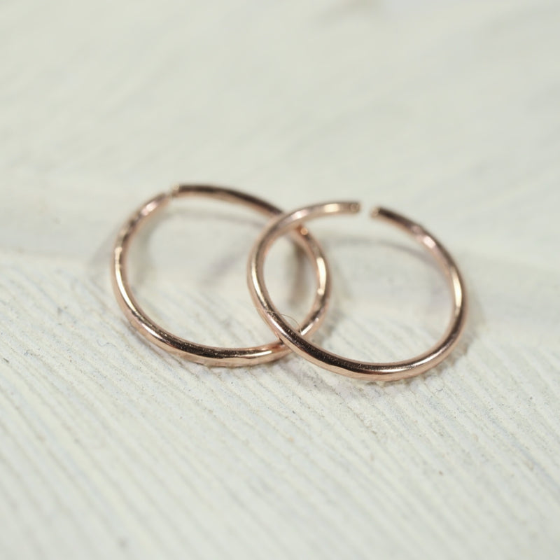 tiny hoop earrings face hammered pink gold