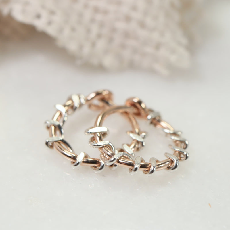 pink gold squiggles with silver accent tiny hoops