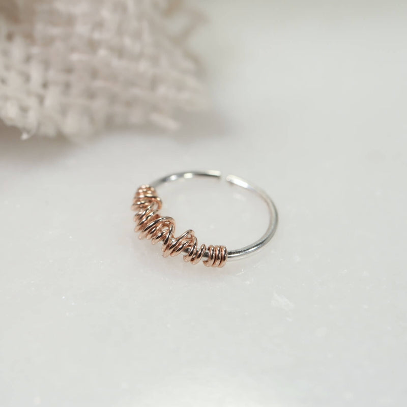 silver tiny hoop earrings with pink gold tangled accent
