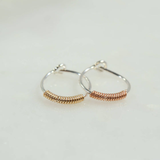 silver tiny hoop earrings with gold or pink gold wrap accent