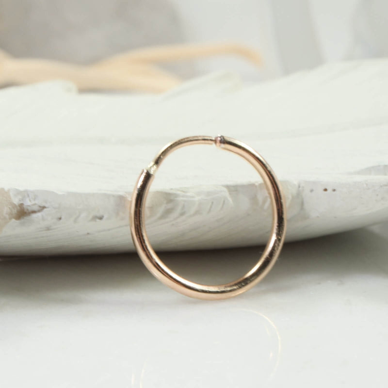 Illusion single hoop earring gold 16 gauge