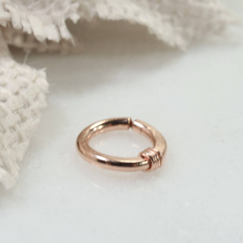 hammered & wrapped hoop earring single pink gold