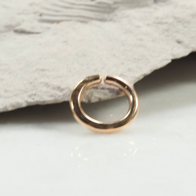 hammered single endless hoop earring gold