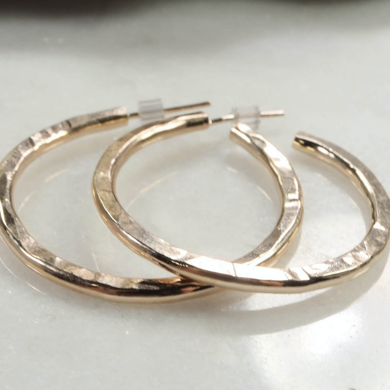above x thick gold hammered hoop earrings