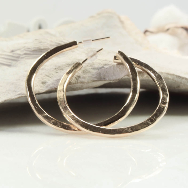 angled view gold hammered hoop earrings