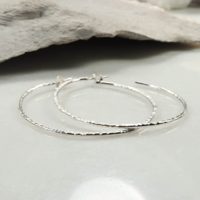 cross cut silver hoop earrings