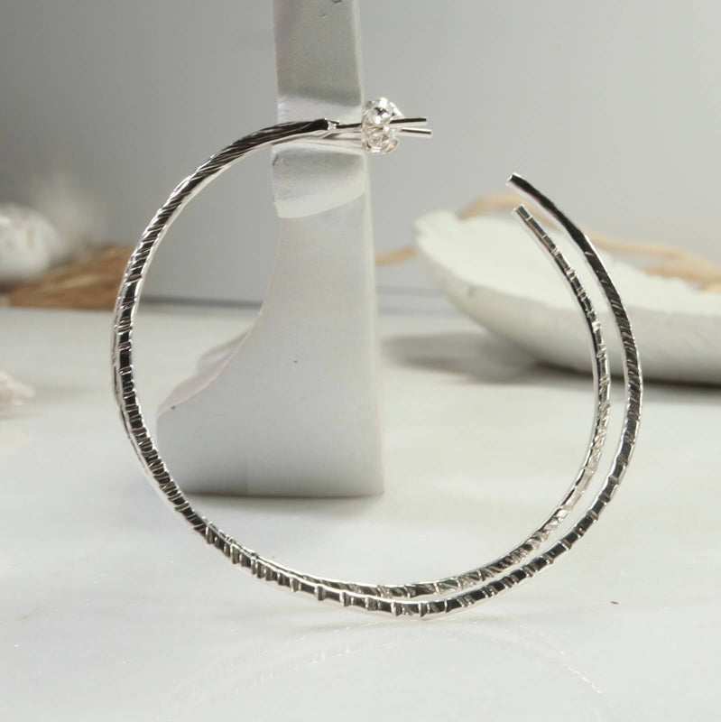 cross cut hoop earrings side view sterling silver
