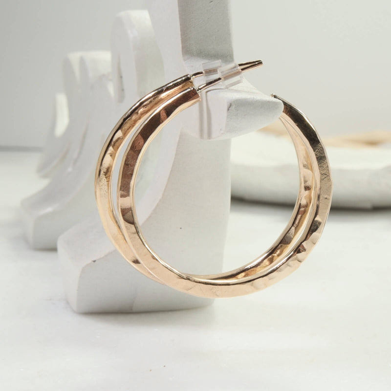 side view x thick gold hammered hoop earrings
