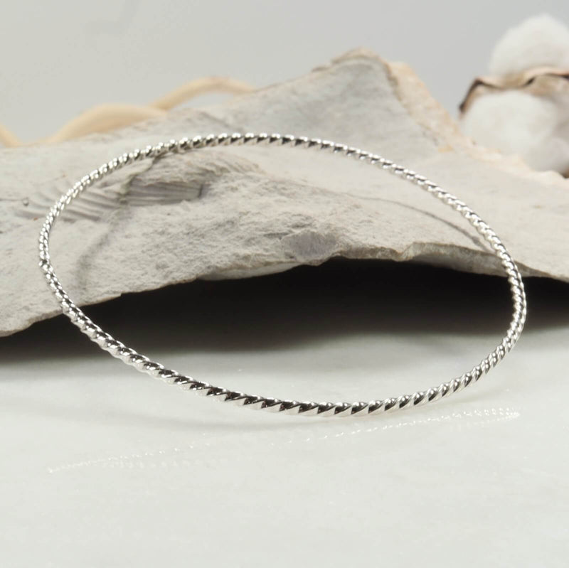 side view silver dot twist bangle