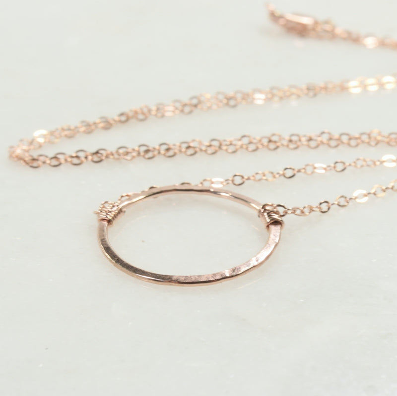 laying down trinity necklace pink gold