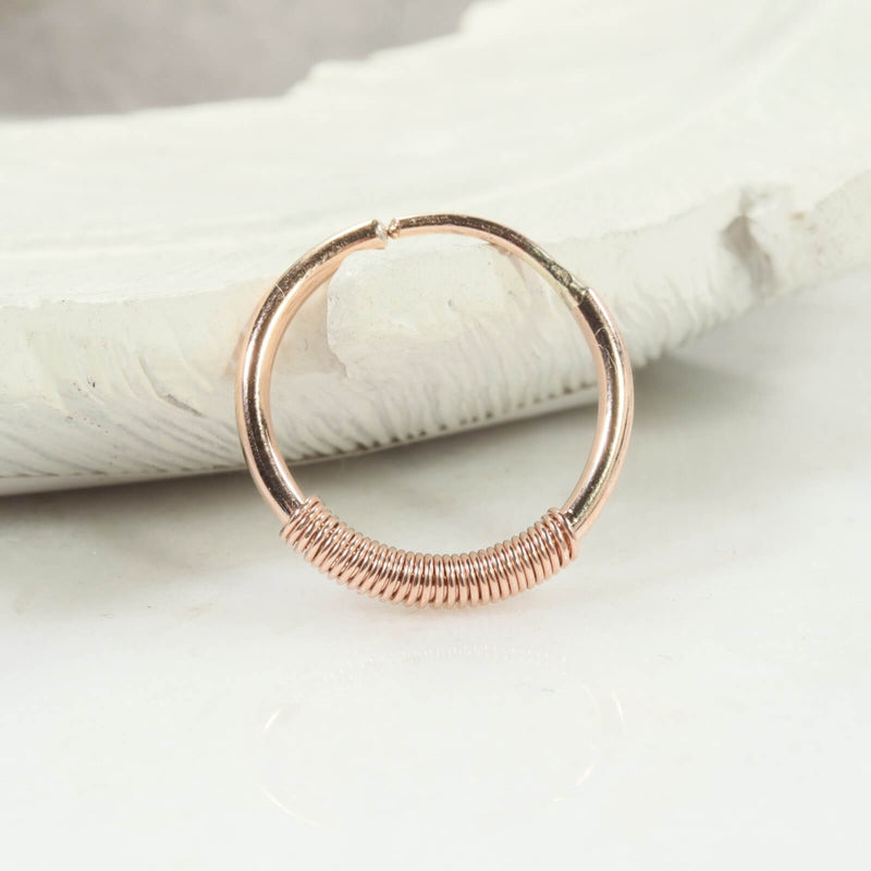 single illusions hoop wrapped in pink gold