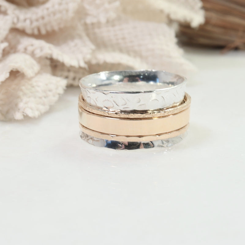 silver spinner ring with gold bands