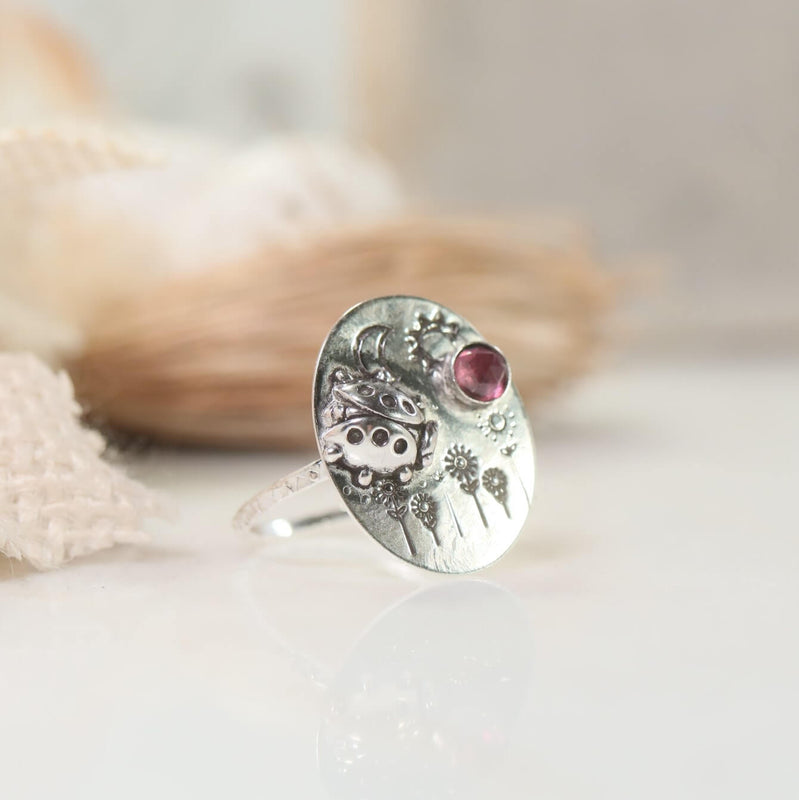 other side ladybug ring with floweers