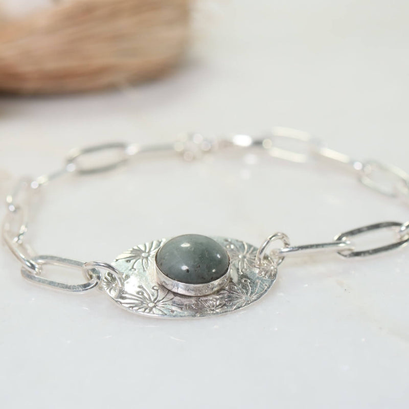 silver nature bracelet with cats eye gemstone