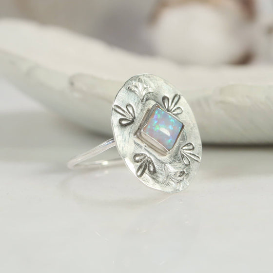 front view flower fire opal ring