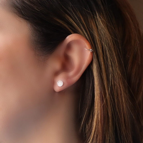 model wearing 4mm hammered dot post earring silver