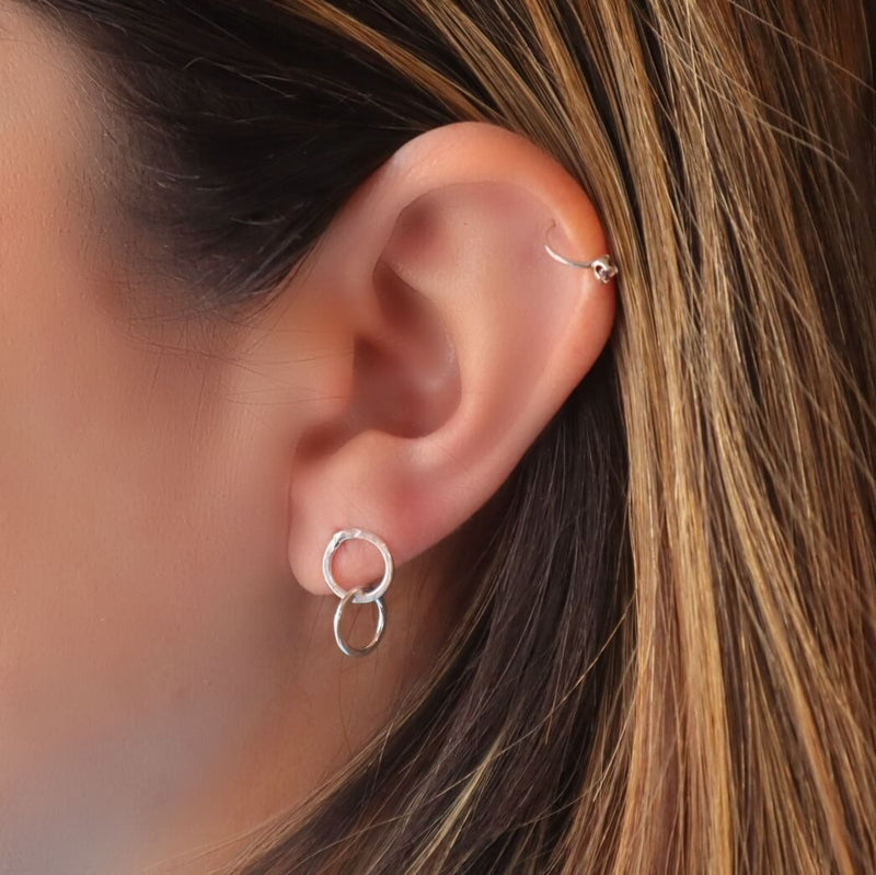 model wearing double circle post earring in silver