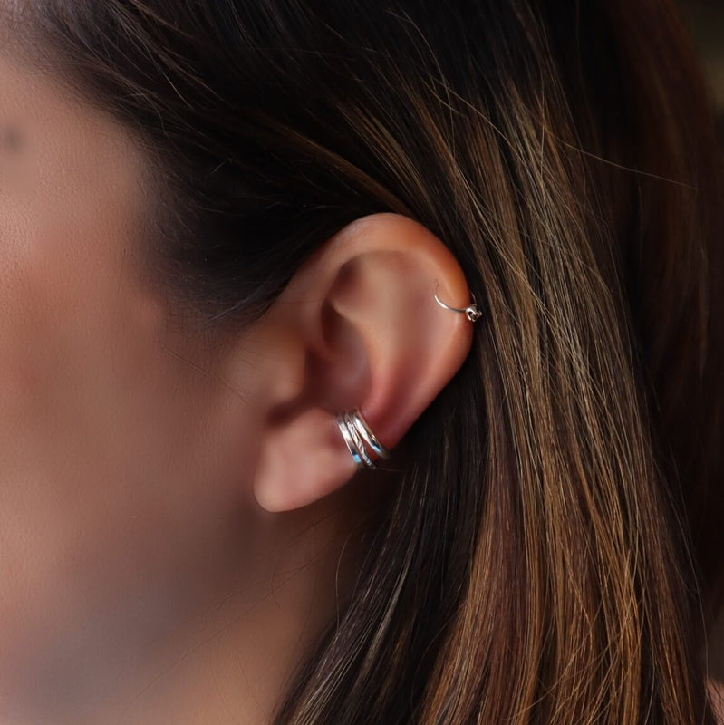model wearing 3 ear cuffs in silver