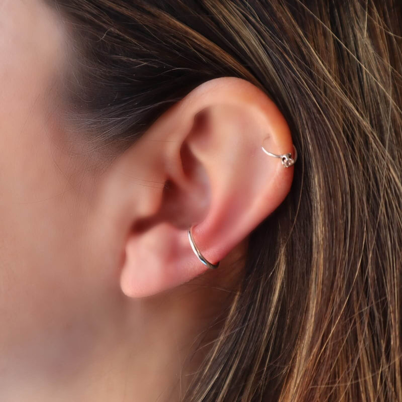 model wearing plain silver ear cuff