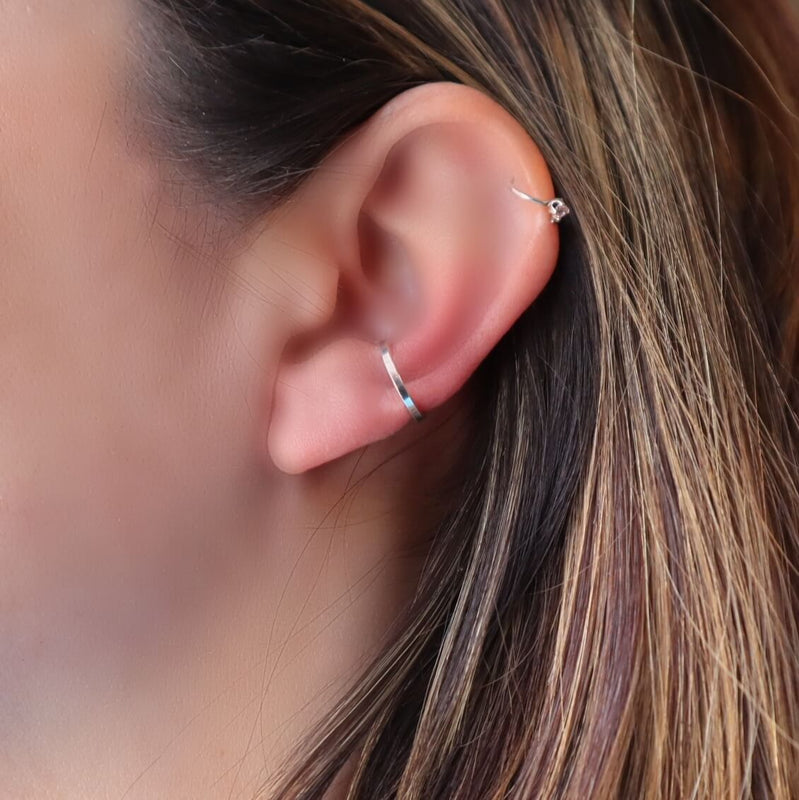 model wearing silver square ear cuff