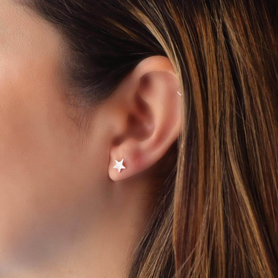 model wearing silver star post earring