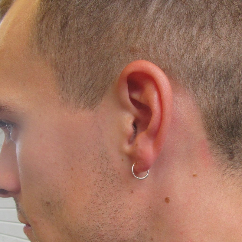 male model wearing hoop earring
