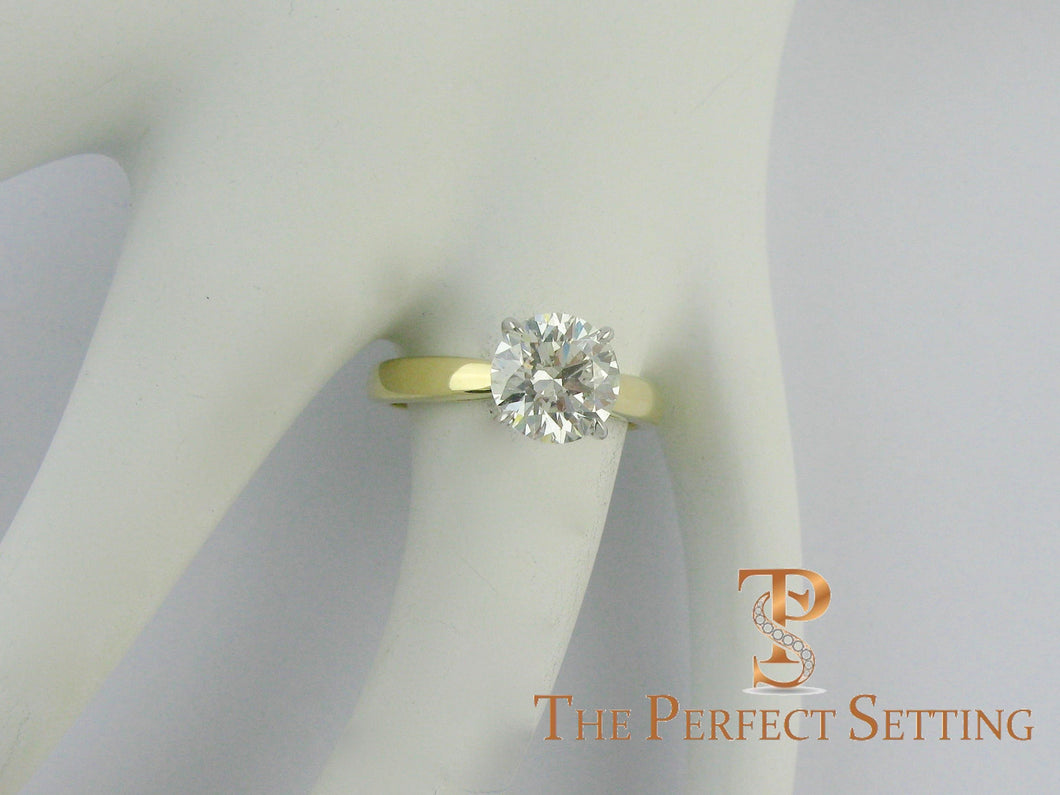 2 ct round diamond yellow gold platinum ring on finger