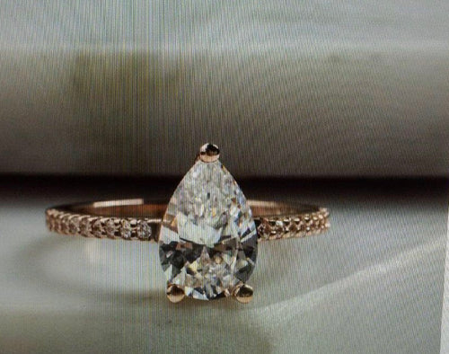 Rose Gold Custom Engagement Ring with Pear Shaped Diamond
