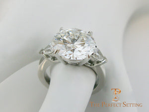7 ct graft round diamond pear 3 stone engagement ring side view