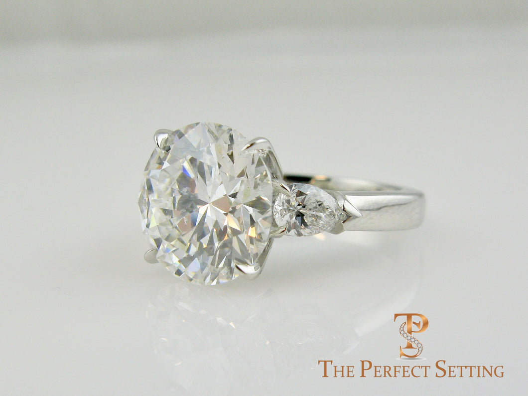7 ct graft round diamond pear 3 stone engagement ring