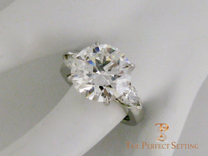 7 ct graft round diamond pear 3 stone engagement ring  finger