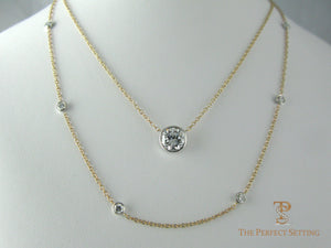 Diamonds bezel set on cable chain in 14K yellow gold