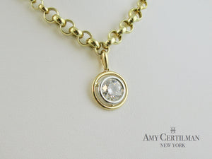 bezel set diamond white and yellow gold pendant