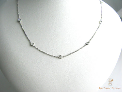 bezel-set necklace round brilliant cut diamonds