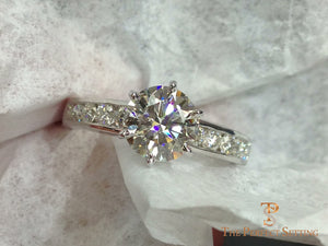 Diamond engagement ring channel setting