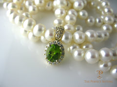 Diamond and tourmaline enhancer on pearl necklace