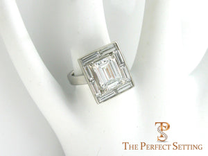 Baguette Halo Emerald Cut Diamond Engagement Ring on finger
