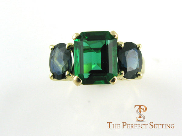 sapphire and emerald cocktail ring gold
