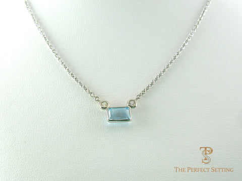 Emerald Cut Aquamarine With Diamond Accents Pendant