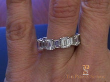 Load image into Gallery viewer, Large and Small Emerald cut diamond eternity band ring selfie