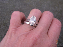 Load image into Gallery viewer, Hammered wedding band with large marquise diamond engagement ring