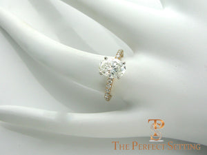 Oval diamond engagement ring rose gold setting on hand