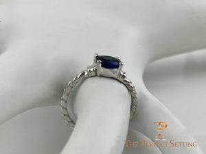 Oval Sapphire Rope Ring side on finger