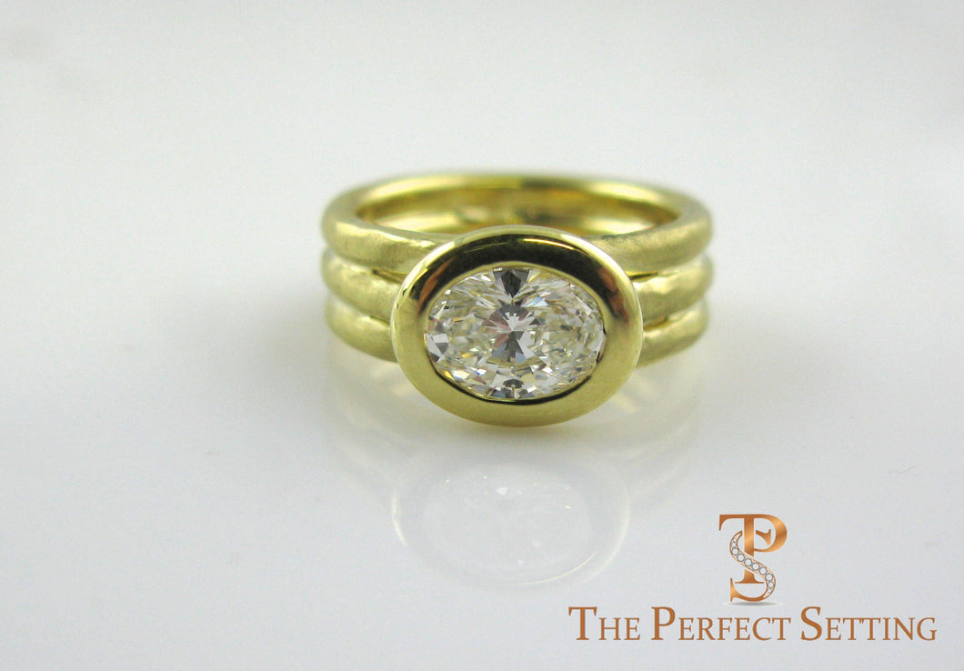 Oval Diamond 18K yellow gold bezel setting right hand ring