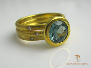 Round Blue Topaz Bezel Set 18K Yellow gold