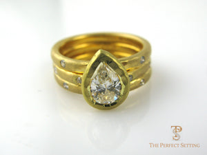 Pear Diamond Bezel Set Ring