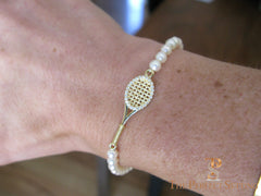 tennis racquet bracelet gold diamonds pearls on wrist