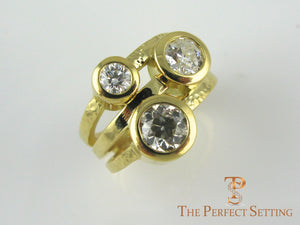 Three Stone Bezel ring in yellow gold