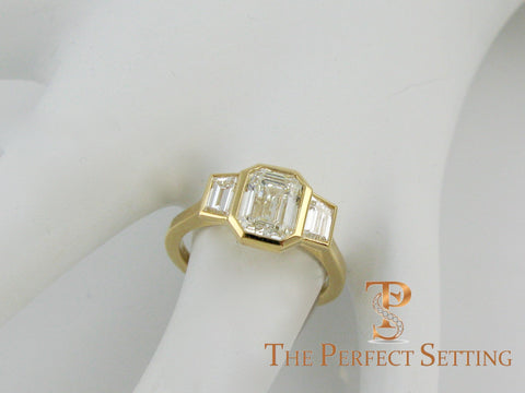 three stone emerald cut diamond custom bezel set ring