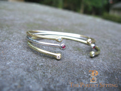 18K gold wire bangle with diamond and rubies